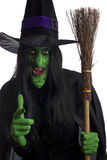Evil witch and her broomstick. Royalty Free Stock Photography
