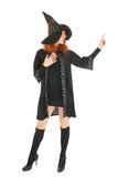 Evil witch pointing with finger Stock Photo