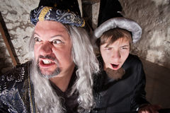 Evil Wizard with Son Stock Images
