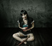 Free Evil Woman Holding Book And  Bloody Ax Royalty Free Stock Image - 45419826