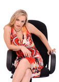 Evil woman sitting in armchair Royalty Free Stock Photos