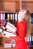 Evil woman with stack of folders Stock Photo