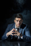 Evil young businessman. Portrait of evil young businessman in his office Royalty Free Stock Image