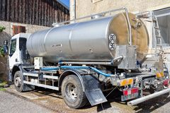 Liquid storage tank car for milk at dairy France. Evillers, France - August 31, 2016: Liquid storage tank car for the milk at the dairy for the production of royalty free stock images