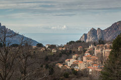 Evisa in Corsica with mountains and sea behind Stock Photos