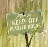 Evite por favor áreas plantadas Fotografia de Stock