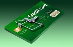 Eviti le trappole della carta di credito, come questa che assomiglia ad una carta di credito trasformata in una trappola per topi immagine stock libera da diritti
