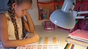 evLittle student doing homework stock video footage