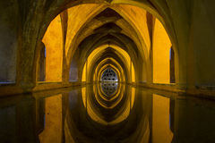 Evocative cave with reflection in water Stock Photo