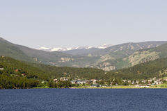 Evocative view of Nederland, Colorado, across Barker Reservoir. Waters of Barker Meadow Reservoir are foreground to town of Nederland in Colorado.  Summer image Royalty Free Stock Photo