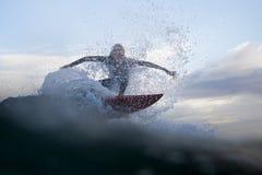 Evolución del agua de la persona que practica surf Foto de archivo libre de regalías