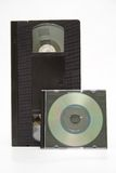 Evolution. VHS cassette and CD disc on white background Royalty Free Stock Image