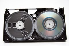 Evolution. Take to pieces VHS cassette and CD disc on white background Royalty Free Stock Images