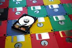 Evolution of digital storage systems. from Floppy Disk to modern Hard Disk Drive. Colored Background Stock Photography