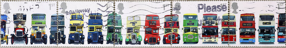 Evolution of english Double-decker bus on 5 different postage stamps. Five british postage stamps showing the front face of of 16 different double-decker buses Stock Photography
