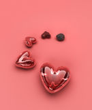 Hearts on red. Hearts growing bigger depicting the evolution of love Royalty Free Stock Images