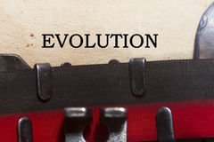 Evolution. Typed on an old vintage paper with od typewriter Stock Photography