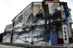 Evolution wall art painted by famous artist, Ernest Zacharevic in Ipoh Royalty Free Stock Images