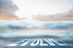Evolve against large city on the horizon. The word evolve against large city on the horizon Stock Photos