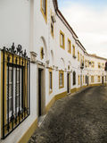 White and yellow traditional houses in Evora, Alentejo region, Portugal Royalty Free Stock Photography