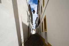 Evora - Small street with white Portugese houses Stock Photography