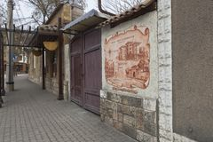 Wall with the image of. Evpatoria, Crimea, Russia - February 28, 2018: Wall with the image of `Dzheval - the quarter of hospitality` on Karaev street in the city Royalty Free Stock Photography