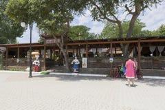 Resorts are photographed near the Khutorok restaurant on the Gorky embankment in the resort town of Evpatoria, Crimea. Evpatoria, Crimea, Russia - June 29, 2018 stock photos