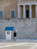Evzone guard in front of the Greek Parliament and tomb of the Unknown soldier Royalty Free Stock Photo
