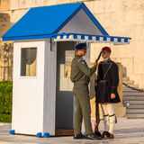 Evzone guarding the Tomb of the Unknown Soldier in Athens dressed in service uniform Stock Photo