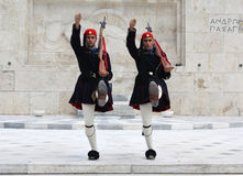 Evzones. (presidential ceremonial guards) in front of the Unknown Soldier's Tomb at the Greek Parliament Building in Athens, opposite Syntagma Square.  guard royalty free stock photos
