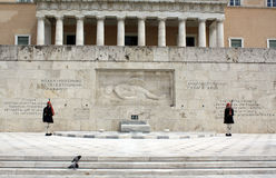 Evzones. (presidential ceremonial guards) in front of the Unknown Soldier's Tomb at the Greek Parliament Building in Athens, opposite Syntagma Square.  guard royalty free stock photo