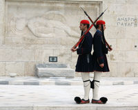 Evzones. (palace ceremonial guards) in front of the Unknown Soldier's Tomb at the Greek Parliament Building in Athens, opposite Syntagma Square.  guard the Tomb royalty free stock photo
