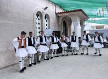 The Evzones with their traditional uniform in Greece. Evzones dance at the feast of the Holy Trinity.The Evzones is the name of several historical elite light royalty free stock photography