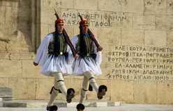 Evzones. Evzone guards marching in front of greek parliament building in Athens, Greece Royalty Free Stock Photography
