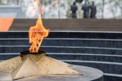 Ewige Flamme auf einem Stadtplatz Lizenzfreie Stockfotografie