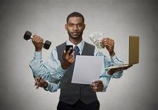 Exécutif occupé multitâche d'homme d'affaires Photo libre de droits