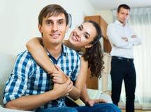 Ex-lover watching girlfriend leaving him Stock Image