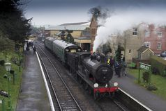 Mid Hants Railway ,Hampshire, England. Ex LSWR Drummond T9 4-4-0 class locomotive number 30120 at Ropley station with a train for Alresford. The Mid Hants stock image
