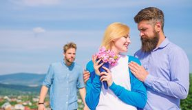 Ex partner watching girl starts happy love relations. Couple in love dating outdoor sunny day, sky background. Leave royalty free stock image