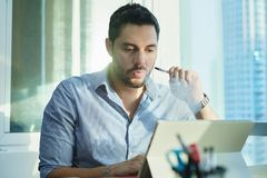 Ex-smoker Man Smoking Electronic Cigarette In Office While Working stock photography