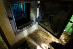 Ex Soviet cold war bunker. All pictures made in low light conditions without any light from outside. Only light was two portable flashlights. Some texts is in Royalty Free Stock Photography