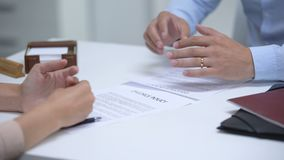 Ex spouses signing divorce policy, removing rings to get rid memories, relations. Stock footage stock video footage