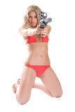 Exact sight. Beautiful girl in red bikini with the big black gun isolated on white Stock Photo