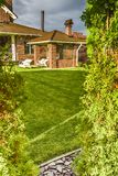 Exactly trimmed grass. Evenly trimmed lawn grass in the backyard Royalty Free Stock Photo