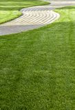 Exactly trimmed grass. Evenly trimmed lawn grass in the backyard Royalty Free Stock Photography