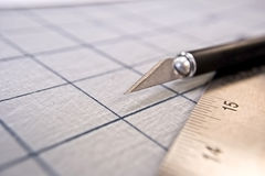 Exacto Knife. Closeup detail of a designer's cutting tool and ruler. Focus on blade Stock Photography