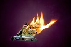 Exaggerated computer overheating problems. A burning graphics adapter card Stock Images