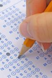 Exam. Person bubbling an answer on a multiple choice exam royalty free stock photos