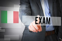 Exam against abstract white room Stock Photo