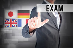 Exam against abstract white room Royalty Free Stock Image